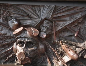 The central panel of the Battle of Britain Memorial shows the brave men of the RAF and their fighter planes