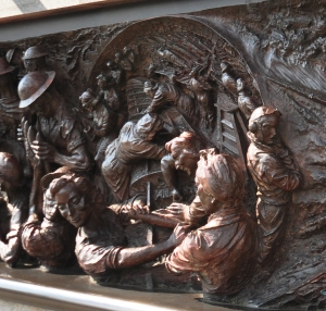The left hand panel of the Battle of Britain Memorial shows the women working in a factory making a wing for a fighter plane