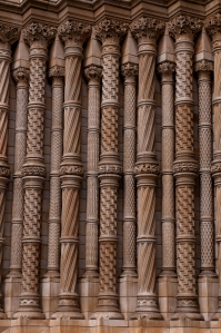 Intricately carved columns that flank the entry to the museum