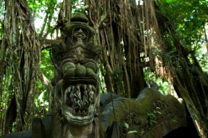 The face of a dragon on the end of the serpentine bridge over a gorge in the Money Forest in Ubud