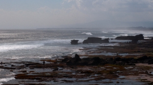 The waves roll in across the Indian Ocean and crash on the shore north of Tanah Lot in Bali